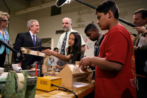 President George W. Bush and Education Secretary Margaret Spellings visit with a teacher and students at Parkland Magnet Middle School for Aerospace Technology in Rockville, Md., Tuesday, April 18, 2006. White House photo by Kimberlee Hewitt