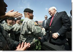 Vice President Dick Cheney greets soldiers at Fort Riley Army Base after delivering remarks at a rally for the troops, Tuesday, April 18, 2006. White House photo by David Bohrer