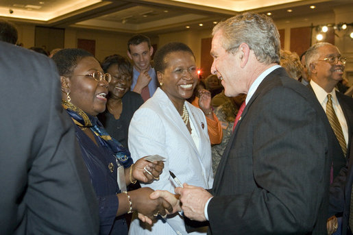 President George W. Bush greets members of the audience after speaking Wednesday, April 19, 2006, at Tuskegee University in Tuskegee, Alabama. White House photo by Paul Morse