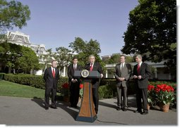 "President George W. Bush talks to the press after visiting with four governors who visited Iraq, Afghanistan, and Kuwait on the South Lawn Wednesday, April 19, 2006. ""I particularly want to thank them for going to see our men and women who are helping secure freedom and peace,"" said President Bush. ""I thank them for sending a message from home that we care about them, we care about our troops, that we'll support our troops, that we appreciate the fact that people are willing to make sacrifices."" White House photo by Eric Draper"