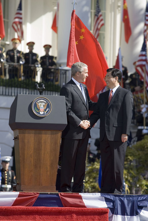 President George W. Bush shakes hands with President Hu Jintao of China after both leaders delivered remarks during a South Lawn arrival ceremony, Thursday, April 20, 2006. White House photo by Eric Draper