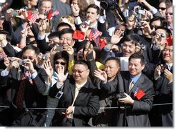 Guests wave enthusiastically as Presidents George W. Bush and Hu Jintao pass by during the South Lawn Arrival Ceremony for the Chinese President, Thursday, April 20, 2006. White House photo by Kimberlee Hewitt