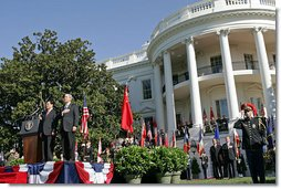 President George W. Bush and Chinese President Hu Jintao stand for the playing of the two countries' national anthems during the beginning of the South Lawn Arrival Ceremony Thursday, April 20, 2006.  White House photo by Shealah Craighead