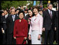 Mrs. Laura Bush stands with Liu Yongqing, the wife of Chinese President Hu Jintao, during the South Lawn Arrival Ceremony, Thursday, April 20, 2006. White House photo by Shealah Craighead