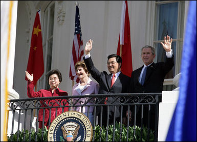 President George W. Bush, Chinese President Hu Jintao, Laura Bush and Hu's wife, Liu Yongqing, wave from the South Portico balcony after the South Lawn Arrival Ceremony at the White House, Thursday, April 20, 2006. White House photo by Shealah Craighead