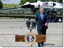President George W. Bush walks to the podium before delivering a statement on the important milestone Iraqis reached today on their path to democracy, Saturday, April 22, 2006 in West Sacramento, California.  White House photo by Eric Draper