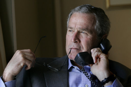 President George W. Bush speaks with Iraqi Parliament Speaker Mahmoud al-Mashhadani during a telephone call in Rancho Mirage, California, Sunday, April 23, 2006. White House photo by Eric Draper