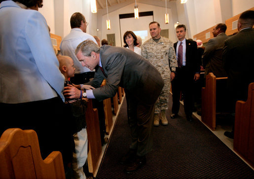 President George W. Bush greets parishioners at the end of a church service at the Marine Corps Air Ground Combat Center in Twentynine Palms, California, Sunday, April 23, 2006. White House photo by Eric Draper