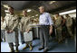 President George W. Bush stands in the chow line with Marines during his visit to Marine Corps Air Ground Combat Center in Twentynine Palms, California, Sunday, April 23, 2006. White House photo by Eric Draper