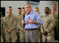 President George W. Bush speaks to Marines and their families following lunch inside the mess hall at the Marine Corps Air Ground Combat Center in Twentynine Palms, California, Sunday, April 23, 2006. White House photo by Eric Draper