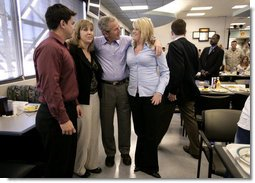 President George W. Bush spends time with Marines and their families following lunch inside the mess hall at the Marine Corps Air Ground Combat Center in Twentynine Palms, California, Sunday, April 23, 2006. White House photo by Eric Draper