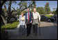President George W. Bush walks with Former President Gerald Ford and Betty Ford after arriving for a visit in Rancho Mirage, California, Sunday, April 23, 2006. White House photo by Eric Draper