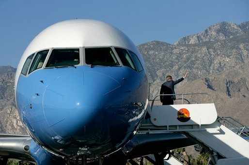 President George W. Bush waves from Air Force One as he prepares to leave Palm Springs for Orange County Monday, April 24, 2006. White House photo by Eric Draper