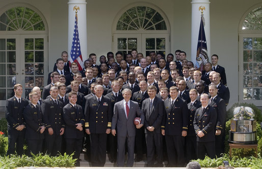 "President George W. Bush poses with the United States Naval Academy football team during the presentation of the Commander-in-Chief Trophy in the Rose Lawn April 25, 2006. ""Seniors on this team have lead one of the most dramatic turn-arounds in college football history,"" said the President. ""Navy has won 26 games in the past three seasons after winning just three games during the previous three years. The seniors are the sixth class in Academy history to have beaten Army all four years."" White House photo by Kimberlee Hewitt"