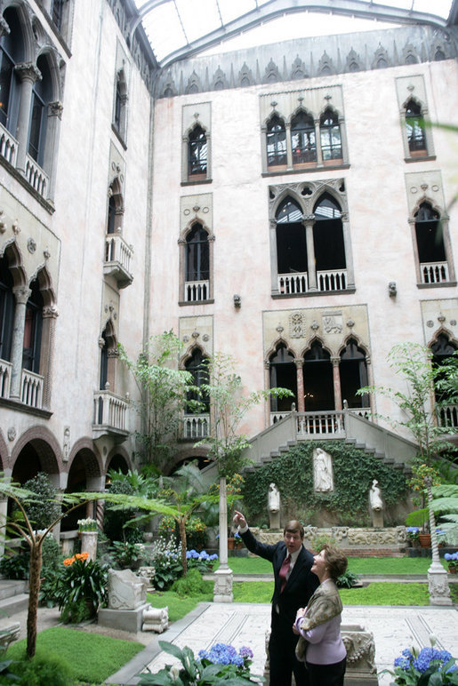 Stan Kozak, Chief Horticulturist of the Gardner Museum, guides Mrs. Laura Bush though a tour of the interior courtyard garden, Tuesday, April 24, 2006, during a visit to the Isabella Stewart Gardner Museum in Boston. The museum is modeled after a 15th century Venetian Palazzo, turned inside out and surrounding the courtyard. White House photo by Shealah Craighead