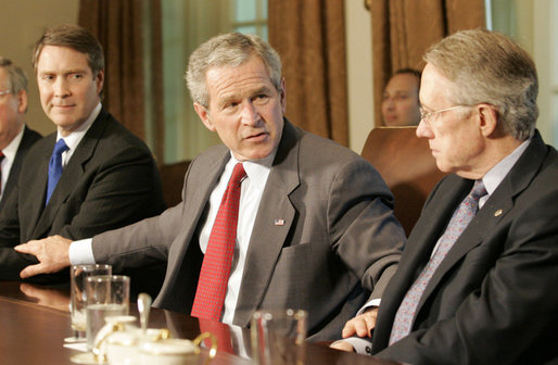 President George W. Bush places his hands on the arm of U.S. Senate Majority leader Senator Bill Frist, R-Tenn., left, and U.S. Senate Democratic leader Senator Harry Reid, D-Nev., right, at the conclusion of a meeting with legislators Tuesday, April 25, 2006 at the White House to discuss immigration reform. President Bush thanked both Republican and Democratic members of the Senate for their hard work to get a comprehensive immigration bill out of the U.S. Senate and hopefully to his desk before the end of this year. White House photo by Eric Draper