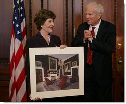 Mrs. Laura Bush is presented with a print by Dr. James Billington, the Librarian of Congress, showing an interior view of the White House as it looked in the early 1900s, Wednesday, April 26, 2006 during the James Madison Council Luncheon at the Library of Congress. White House photo by Kimberlee Hewitt