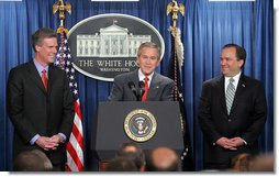 President George W. Bush and outgoing Press Secretary Scott McClellan introduces the new White House Press Secretary, Tony Snow, to the press in the James S. Brady Press Briefing Room Wednesday, April 26, 2006.  White House photo by Kimberlee Hewitt