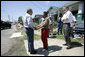 President George W. Bush greets homeowner Ethel Williams during a visit to her hurricane damaged home in the 9th Ward of New Orleans, Louisiana, Thursday, April 27, 2006. White House photo by Eric Draper