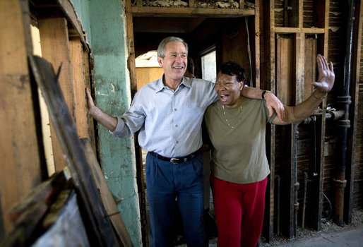 President George W. Bush shares a light moment with homeowner Ethel Williams during a visit to her hurricane damaged home in the 9th Ward of New Orleans, Louisiana, Thursday, April 27, 2006. White House photo by Eric Draper