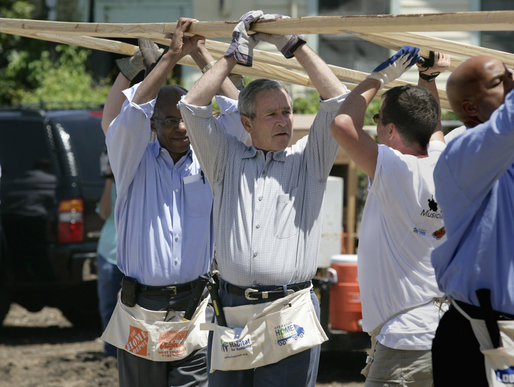 President George W. Bush helps volunteers from Operation Rebuilding Hands with the construction of a home in New Orleans, Louisiana, Thursday, April 27, 2006. Also pictured are Congressman Bill Jefferson, left, and New Orleans Mayor Ray Nagin. White House photo by Eric Draper