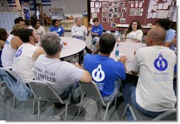 President George W. Bush meets with volunteers from Hands On Network at their base camp in Biloxi, Mississippi, Thursday, April 27, 2006.  White House photo by Eric Draper