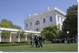 President George W. Bush walks across the Rose Garden with Al Hubbard of the National Economic Council, left, and Ed Lazear of the Council of Economic Advisors, after addressing the press Friday, April 28, 2006.  White House photo by Paul Morse