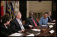 "President George W. Bush meets with Darfur advocates, including former slave Simon Deng, in the Roosevelt Room Friday, April 28, 2006. ""I just had an extraordinary conversation with fellow citizens from different faiths, all of who have come to urge our government to continue to focus on saving lives in Sudan,"" said the President to the press. ""They agree with thousands of our citizens -- hundreds of thousands of our citizens -- that genocide in Sudan is unacceptable."" White House photo by Paul Morse"