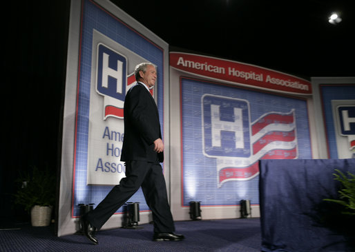 "President George W. Bush steps onto the stage at the Washington Hilton Hotel Monday, May 1, 2006, prior to delivering his remarks on health care initiatives. Said the President, ""America has the best health care system in the world, pure and simple."" White House photo by Paul Morse"