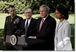 President George W. Bush makes a statement to the press regarding the recent trip to Iraq by Secretary Rumsfeld and Secretary Rice on the South Lawn May 1, 2006. The President is standing with, from left, Chairman of the Joint Chiefs of Staff Peter Pace, Defense Secretary Donald Rumsfeld and State Secretary Condoleezza Rice. White House photo by Eric Draper