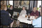 Mrs. Laura Bush and Mrs. Janet Huckabee, left, visit with patrons Tuesday, May 2, 2006 at Bailey's Bakery in Ft. Smith, Ark. Mrs. Bush traveled to Arkansas to remind seniors of the May 15th enrollment deadline to sign-up for the Medicare Prescription Drug Benefit. White House photo by Kimberlee Hewitt
