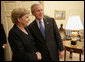 President George W. Bush welcomes German Chancellor Angela Merkel to the Oval Office at the White House, Wednesday, May 3, 2006. White House photo by Eric Draper