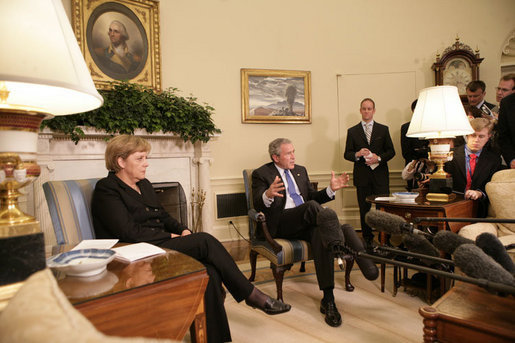 President George W. Bush speaks to members of the media during his meeting with German Chancellor Angela Merkel in the Oval Office at the White House, Wednesday, May 3, 2006. White House photo by Eric Draper