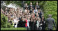 President George W. Bush is greeted by applause as he arrives on the South Lawn Wednesday, May 3, 2006, by recipients of the 2005 Presidential Awards for Excellence in Mathematics and Science Teaching. White House photo by Eric Draper
