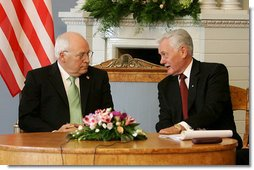 Vice President Dick Cheney listens to Lithuanian President Valdus Adamkus during a bilateral meeting held at the Presidential Palace in Vilnius, Lithuania, Wednesday, May 3, 2006. During the meeting the two leaders discussed their mutual determination to further the rise of democracy in the region.  White House photo by David Bohrer