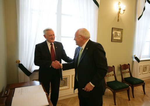 After signing the guest book at the Presidential Palace in Vilnius, Lithuania, Vice President Dick Cheney shakes hands with Lithuanian President Valdus Adamkus, Wednesday May 3, 2006. The two leaders participated in a bilateral meeting to discuss regional issues prior to the beginning of the Vilnius Conference 2006, a summit gathering heads of state from the Baltic and Black Sea regions that begins Thursday. White House photo by David Bohrer