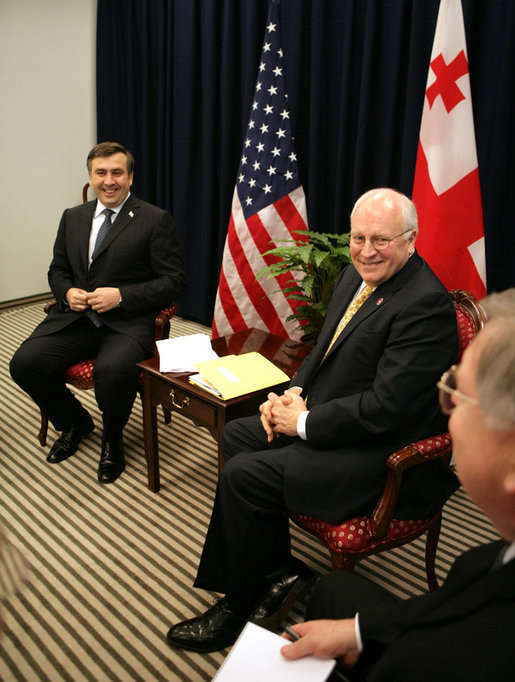 Vice President Dick Cheney and President Mikheil Saakashvili of Georgia, share a light moment with U.S. Ambassador John Tefft, right, during a bilateral meeting held during the Vilnius Conference 2006 in Vilnius, Lithuania, Thursday, May 4, 2006. White House photo by David Bohrer