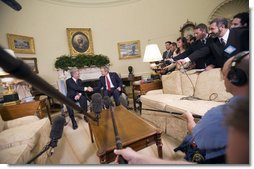 President George W. Bush visits with President Tabare Vazquez of Uruguay in the Oval Office Thursday, May 4, 2006. White House photo by Eric Draper