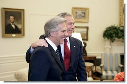 President George W. Bush and President Tabare Vazquez of Uruguay talk with the press in the Oval Office Thursday, May 4, 2006. White House photo by Eric Draper