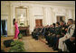 President George W. Bush and guests listen to artist Graciela Beltran perform during the White House celebration of Cinco De Mayo in the East Room Thursday, May 4, 2006. White House photo by Paul Morse