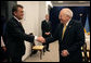 Vice President Dick Cheney and Ukrainian President Viktor Yushchenko greet one another before beginning a breakfast meeting, Thursday, May 4, 2006 in Vilnius, Lithuania. Both leaders have come to Vilnius to participate in the Vilnius Conference 2006, a summit of leaders of the Baltic and Black Sea regions. White House photo by David Bohrer