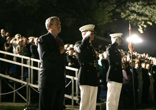 President George W. Bush stands at attention Friday, May 5, 2006, during an Evening Parade at the Marine Barracks in Washington, D.C. The President and Mrs. Laura Bush spent the evening meeting with U.S. Marine Corps Noncommissioned Officers of the Year and wounded Marines. White House photo by Paul Morse