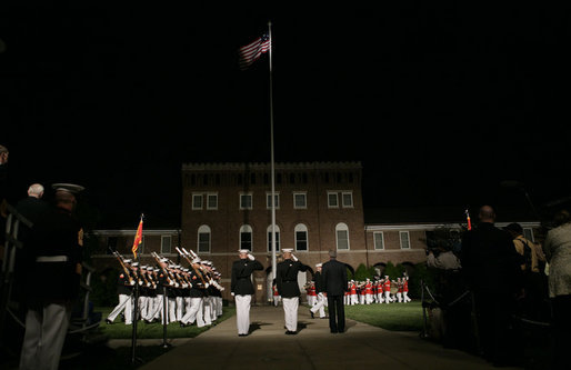 President George W. Bush stands for the March in Command Review during an Evening Parade, May 5, 2006, at the Marine Barracks in Washington, D.C. White House photo by Paul Morse
