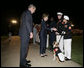 President George W. Bush and Laura Bush greet Marines following an Evening Parade, May 5, 2006, at the Marine Barracks in Washington, D.C. White House photo by Paul Morse