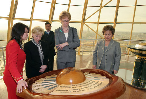 Mrs. Lynne Cheney looks at a display Friday, May 5, 2006, commemorating the first Congress of World Religions, an initiative of President Nazarbayev, that was held in Astana, Kazakhstan in 2003. With her from left are: Murat Gabdrashitov Sapargaliyev, director of Biterek; Maryjo Ordway, wife of John Ordway, U.S. Ambassador to Kazakhstan, and Sabilya Mustafina, deputy Mayor of Astana. Photo by Aleksandr Zhabchuk