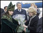 A Kazakh woman adorned in ceremonial dress welcomes Mrs. Lynne Cheney to Astana, Kazakhstan, with a bouquet of flowers, Friday, May 5, 2006. White House photo by David Bohrer