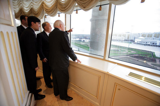 From a high window in the Presidential Palace, Kazakh President Nursultan Nazarbayev points out places of interest along the Astana, Kazakhstan skyline, Friday, May 5, 2006. White House photo by David Bohrer