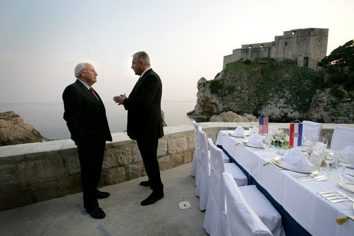 Vice President Dick Cheney talks with Croatian Prime Minister Ivo Sanader before a dinner meeting, Saturday, May 6, 2006, in the Old City of Dubrovnik, Croatia. The Vice President met with the Prime Minister to express U.S. support of Croatia's ambitions to become a member of the transatlantic community through integration into NATO and the European Community. White House photo by David Bohrer