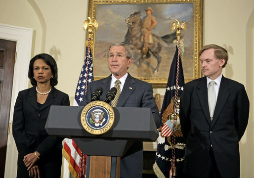"President George W. Bush delivers a statement on Darfur in the Roosevelt Room Monday, May 8, 2006. Standing with the President are State Secretary Condoleezza Rice and State Deputy Secretary Robert Zoellick. ""About 200,000 people have died from conflict, famine and disease,"" said the President. ""And more than 2 million were forced into camps inside and outside their country, unable to plant crops, or rebuild their villages. I've called this massive violence an act of genocide, because no other word captures the extent of this tragedy."" White House photo by Paul Morse"