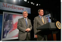 President George W. Bush is introduced by his brother Florida Governor Jeb Bush before delivering remarks on the Medicare Prescription Drug Benefit in Sun City Center, Florida, Tuesday, May 9, 2006. White House photo by Eric Draper
